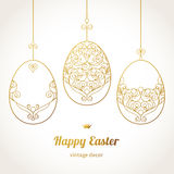 Golden ornamental eggs for your Easter design. Spring element in Eastern style. Traditional vintage decor for invitations, greeting cards. Ornate pattern for Stock Images