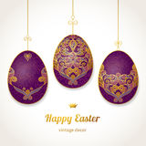 Golden ornamental eggs for your Easter design. Spring element in Eastern style. Traditional vintage decor for invitations, greeting cards. Ornate pattern for Stock Photo