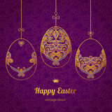 Golden ornamental eggs for your Easter design. Spring element in Eastern style. Traditional vintage decor for invitations, greeting cards. Ornate pattern for Stock Photography