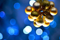 Golden Ornaments. Golden Christmas Ornaments - Blue Light Bokeh Background. Christmas Photo Collection Royalty Free Stock Image