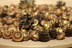 Golden ornaments for Christmas. On wood plate Stock Image