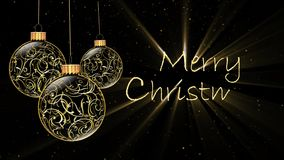 Golden Ornaments Merry Christmas 4K. Features golden filigree Christmas ornaments rotating and a black background with golden flecks of snow falling and an stock video footage