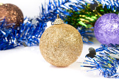 Golden ornaments on tinsel decoration Stock Photo