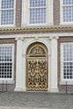 Golden ornate entrance door Stock Photo