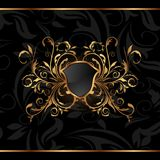 Golden ornate frame with shield Royalty Free Stock Photos