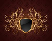 Golden ornate frame with shield Stock Photo