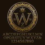 Golden ornate letters and numbers with W initial monogram. Decorative patterned font for logo design. Isolated english vintage alphabet, figures Stock Photo
