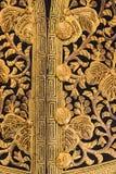 Golden ornate vintage clothing button Stock Photo