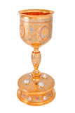 Golden orthodox altar chalice. Isolated rich decorated golden orthodox church chalice on a white background stock photo