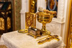Golden orthodox utensils with holy bible royalty free stock photo