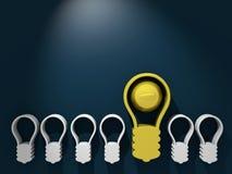 Golden outstanding lighting bulb among gray others Stock Photo