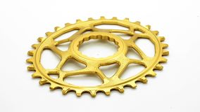 Golden oval bicycle chainring gear stock footage