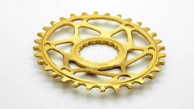 Golden oval bicycle chainring gear rotating stock video