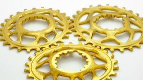 Golden oval bicycle chainring gears stock footage