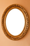 Golden oval frame. Golden color oval frame on a wall Royalty Free Stock Images