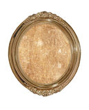 Golden oval photo frame with old brown canvas inside.Isolated. Royalty Free Stock Photography