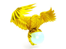 Golden owl figure and magical ball. Isolated on white background stock photo
