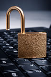 Golden padlock on computer keyboard Royalty Free Stock Photos
