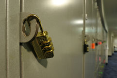 Golden padlock on a locker cupboard Royalty Free Stock Photography
