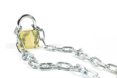 Golden Padlock And Metal Chain Isolated On White Background, Closeup. Studio Shot Stock Photography
