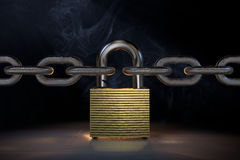 Golden padlock between two iron chains Royalty Free Stock Photos