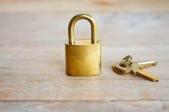 Golden padlock on wood Royalty Free Stock Photo