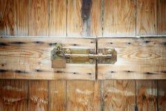 Golden padlock on wooden door, detail Stock Image