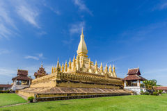Golden pagada in Pha-That Luang tample on blue sky background Stock Photography