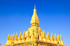 Golden pagada in Wat Pha That Luang Stock Photo