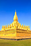 Golden pagada in Wat Pha That Luang Stock Image