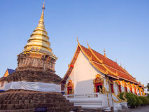 Golden pagoda behind main church in Thai temple Royalty Free Stock Images