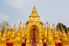 Golden pagoda with blue sky Stock Photo