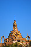 Golden pagoda in the blue sky background Stock Photos