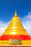 Golden pagoda with blue sky day and thai wording. For spiritual prayer Stock Photography