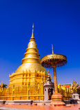 Golden Pagoda in blue sky. Hariphunchai temple,in Lumphun Thailand Royalty Free Stock Images