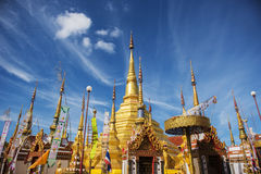 Golden pagoda and blue sky at Phra Borommathat temple Tak Province ,Thailand. Royalty Free Stock Photography