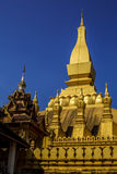 Golden Pagoda with Blue Sky at Wat Pha That Luang - Vientiane, L Royalty Free Stock Image
