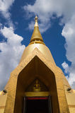 Golden pagoda with blue sky. Golden pagoda of Wat Tumsaengpet, Amnatcharoen, Thaialnd stock photo