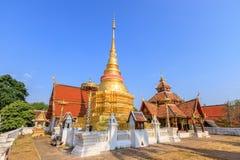 Golden pagoda and Buddha pavilion at Wat Pong Sanuk temple and museum in Lampang, North of Thailand royalty free stock photos
