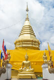 Golden pagoda. And buddha sculpture in Thai temple Royalty Free Stock Photos