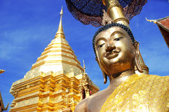 Golden pagoda with buddha statue Royalty Free Stock Image