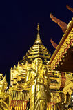 Golden Pagoda and buddhist statue. On twilight in wat Prathart Doi Suthep,Chiang mai,Thailand Royalty Free Stock Images