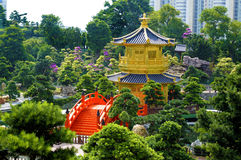 Golden Pagoda and Chinese garden, Kowloon, Hong Kong. Golden Pagoda and red bridge in Nan Lian gardens, Kowloon City, Hong Kong, known as the Pavilion of Stock Photo