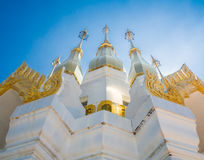 Golden Pagoda with clear bleu sky in Buddhism Temple, Ubon Ratch Royalty Free Stock Photography