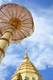 Golden pagoda contain Buddha ash on ancient temple in Thailand Royalty Free Stock Photography