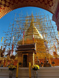 Golden pagoda frame with arched entrance under reconstruction Royalty Free Stock Photos