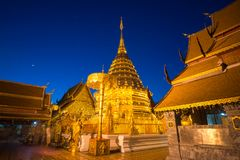 Golden pagoda holy temple at twilight. Golden pagoda holy temple twilight, Wat Phrathat Doi Suthep, locates in Chiang Mai, Thailand. The ancient temple is very Stock Image
