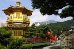 Golden Pagoda, Kowloon, Hong Kong, buddhist temple, Chinese garden. Golden Pagoda and red bridge in Nan Lian gardens, Kowloon, Hong Kong, also known as the Royalty Free Stock Photography