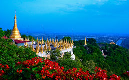 Golden Pagoda on Mandalay Hill, Mandalay, Myanmar. Mandalay Hill is a major pilgrimage site. A panoramic view of Mandalay from the top of Mandalay Hill alone stock images