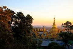 The golden pagoda at Mandalay hill viewpoint during sunset royalty free stock photography